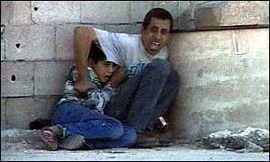 Mohamed al Dura and his father.