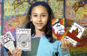girl holding cards