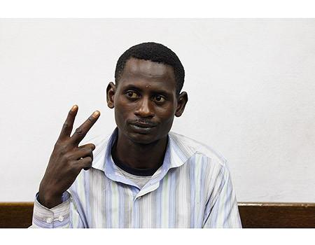 Suleiman Abdul-Adham gestures the V-sign