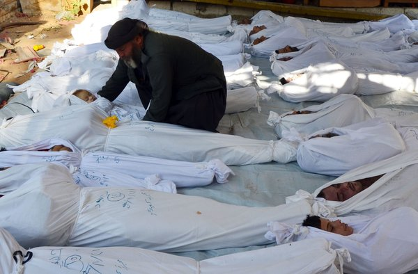 man with body of dead child