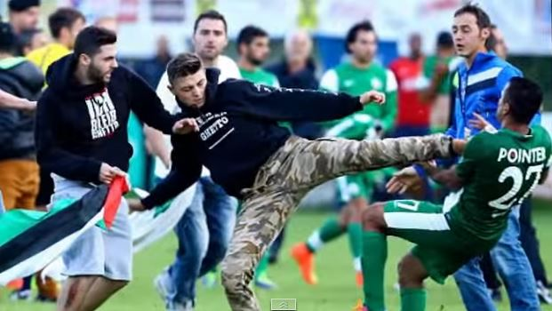 A pro-Palestinian protester attacks a Maccabi Haifa player