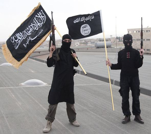 ISIS jihadists flying the black flag in Syria (Reuters)