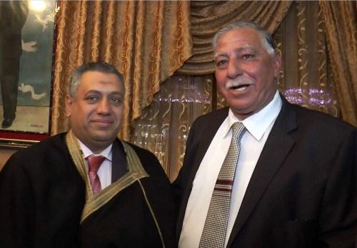 Dawaima (left) in Saddam Hussein's robe.