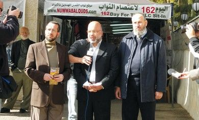 Hamas men in front of Jerusalem Red Cross compound