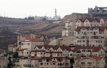 Mosque  behind houses in settlement of Efrat, December 2011.